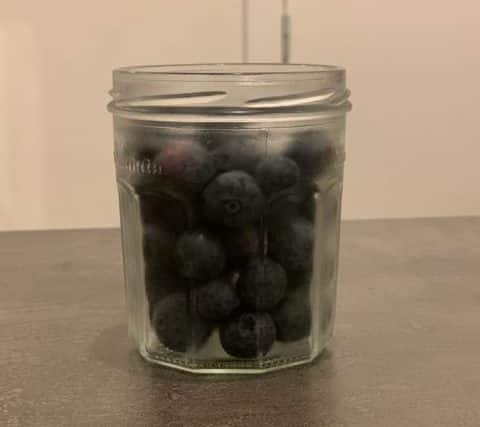 Squared jar with blueberries