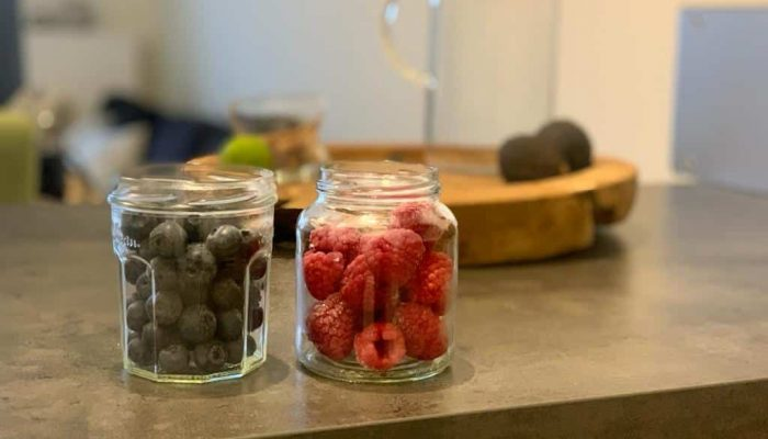 Mason jars with fruits in them