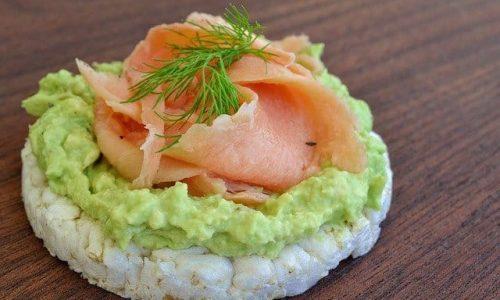 Rice cake with avocado and salmon